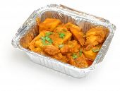 Indian 'Bombay aloo' potato curry in takeaway container