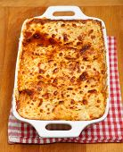 Freshly baked lasagna in casserole dish