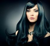 Beauty Woman. Beautiful Brunette Luxury Girl. Healthy Long Black Hair and Holiday Makeup. Jewelry. J