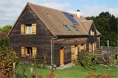 foto of tile cladding  - French Wooden House with Solar Panels and shutters - JPG