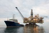 foto of oil derrick  - Oil rig being tugged in the sea - JPG