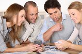 Business meeting around table with electronic devices