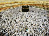 Kaaba in Mecca, Muslim people praying together at holy place
