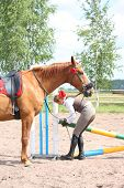 Beautiful Young Blonde Woman Setting The Barrier For Show Jumping
