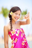 Hawaii beach woman making Hawaiian shaka hand sign. Pretty and free asian girl enjoying vacation hol