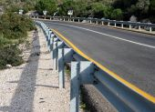 Road With Guardrail In Perspective