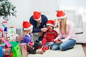image of rudolf  - Playful family with Christmas gifts and ornaments sitting at home - JPG