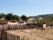 picture of mud-hut  - View of thatched mud homes in typical african village in Zimbabwe - JPG