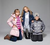 Children in winter clothes. Kids in down jackets. Fashion child