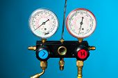 pressure and temperature control meter against blue background