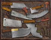 vintage kitchen utensils collage over rusty plate