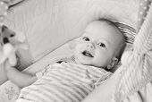 stock photo of teething baby  - Cute baby smiling looking at the camera  - JPG
