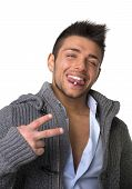 Attractive Young Man With Tongue Piercing, Doing Victory Sign