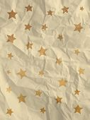 Wrapping paper with doodle stars on crumpled paper texture