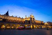 KRAKOW, POLAND - APR 7, 2014: Sukiennice on Rynek Glowny (Market Square) in night time. Rynek Glowny - roughly 40,000 m2 is largest medieval town square in Europe.