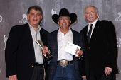 LAS VEGAS - APR 6:  Bob Romero, George Strait, Jerry Jones at the 2014 Academy of Country Music Awar