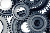 stock photo of interlock  - Closeup of metal cog gears - JPG