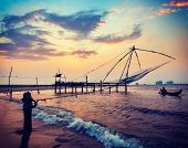 stock photo of fishnet  - Vintage retro hipster style travel image of Kochi chinese fishnets on sunset - JPG
