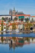 View of Charles bridge over Vltava river and Gradchany (Prague Castle) and St. Vitus Cathedral, Prag