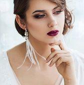 Portrait of beautiful woman in white dress