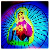 Instagram style image of a neon Virgin Mary