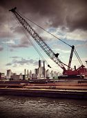 Instagram style image of a crane with lower Manhattan skyline in background
