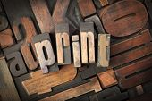 print written with vintage letterpress printing blocks on random letters background