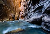 Virgin River Flows Through The Narrows Of Zion Canyon National Park In Utah