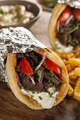 pic of gyro  - Homemade Meat Gyro with Tzatziki Sauce tomatos and French Fries