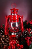 Red kerosene lamp on dark color background