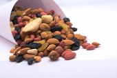 foto of cornucopia  - Cornucopia with almond cashew raisin black yellow apricot bone hazelnut walnut peanut