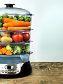 Healthy food in steamer, steam cooker with various vegetables