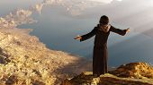 stock photo of priest  - Priest piously on the mountain - JPG