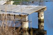 picture of dock a pond  - small wooden pontoon for fishing in a pond - JPG