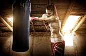 Young woman boxing workout on the attic