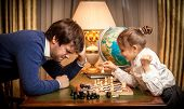 stock photo of little girls photo-models  - Photo of little girl won chess at man - JPG