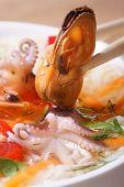 Mussel Hold Chopsticks Close Up Vertical