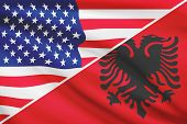 image of albania  - Flags of USA and Albania blowing in the wind - JPG