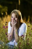 Woman Sneezes With Allergies