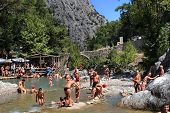 Kemer, Turkey,  Taurus Mountains, Tourists Swimming In A Mountain River.