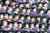 Shot Of Graduation Caps During Commencement. The Image Was Blurred For Use As A Background.