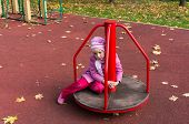 sad girl on the carousel