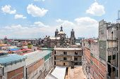 Day View Of Mexico City Downtown From Roofs