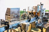 stock photo of manufacturing  - Automatic packing line of conveyor - JPG