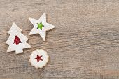 stock photo of linzer  - Overhead view of 3 linzer christmas cookies on a wooden background - JPG