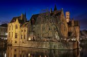 Canals And Old Buildings Of Bruges