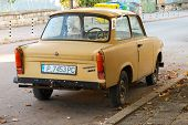 Old Yellow Trabant 601S Car Stands Parked On A Street