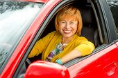 Portrait of older woman driving a car