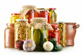 picture of pickled vegetables  - Composition with jars of pickled vegetables - JPG