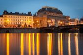 National Theater in Prague during the evening viewed from Vltava river